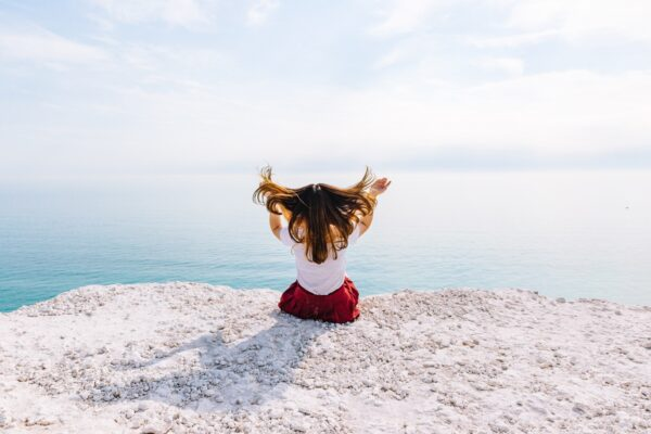 Girl sitting out looking over the sea