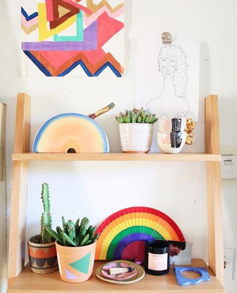 rainbows and art on ladder