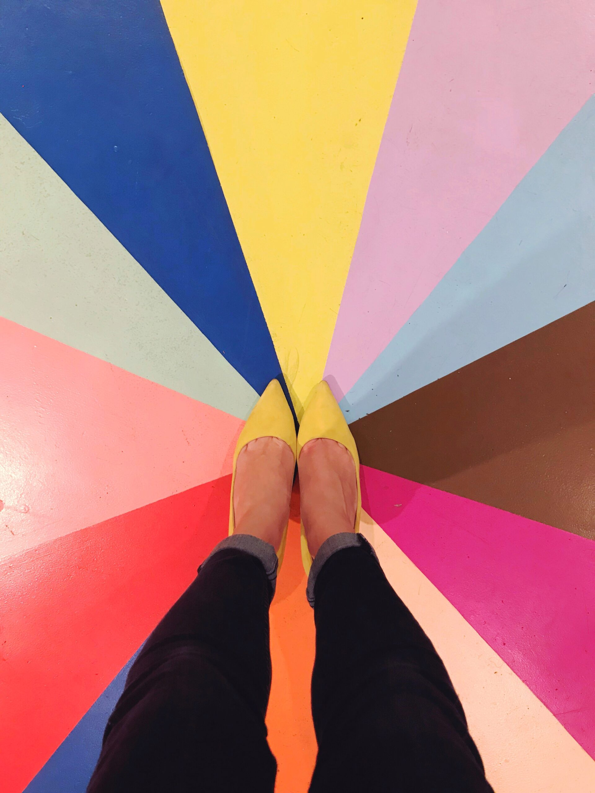 Yellow shoes on a multicolored background
